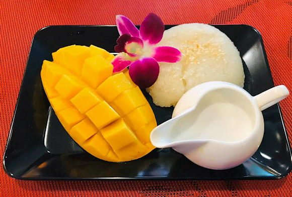 Free sticky rice with mango by every meal