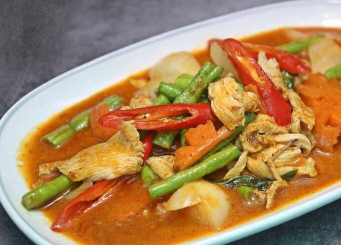 Stir fried chicken and red curry paste