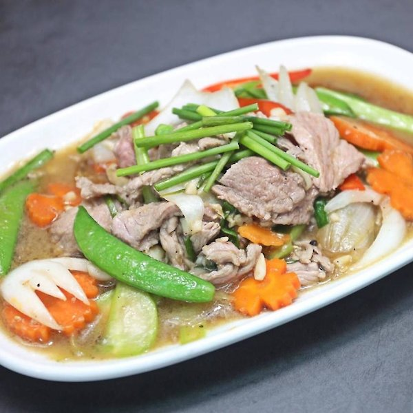 Stir-fried beef with green onions
